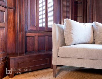 Chelsea Blanchard created a stylish solution for hiding unattractive baseboard heat. Wrapped in decorative molding, these baseboards blend seamlessly with the room's architecture. Carefully placed air vents allow for proper heat circulation.