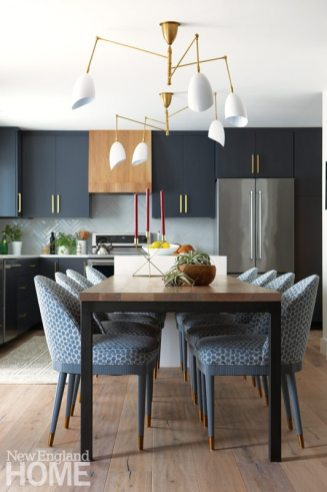 Blue kitchen with large dining table
