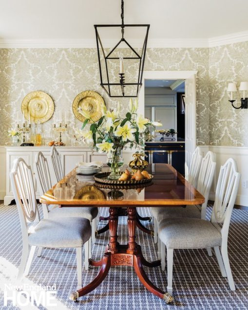 Traditional dining room with mahogany table with white chairs