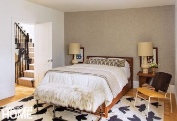 Neutral master bedroom with fur bench