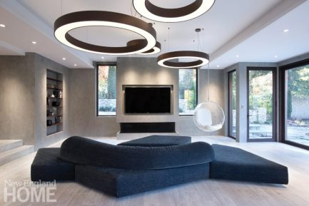 Contemporary open concept family room with blue chenile couch