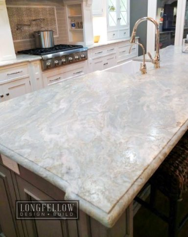 Recent trends show a move toward using more textured and tactile finishes in the home. This leathered quartzite countertop has a soft sheen, irresistibly luxurious feel and hides fingerprints and watermarks.
