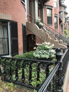 A classic garden urn complements the classic architecture of this Boston townhome.