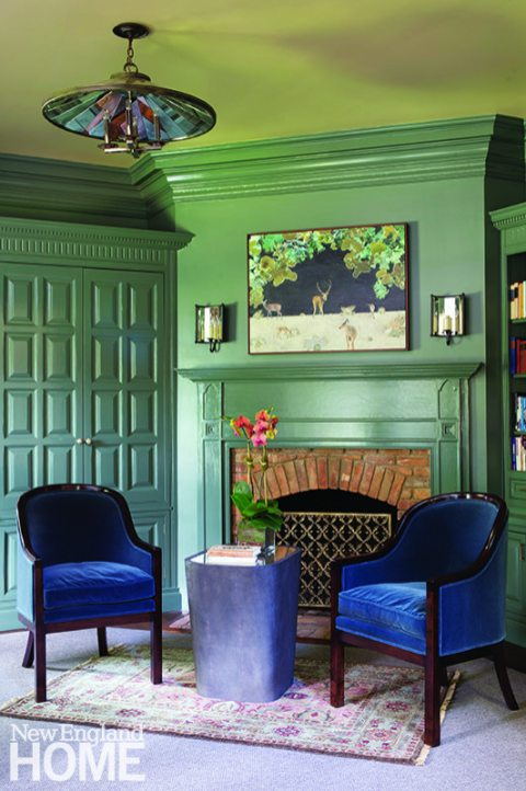 Formerly stained wood, the study underwent a bold transformation, with all the cabinetry and millwork getting a high-gloss coat of Farrow & Ball's Green Smoke.