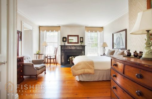 The fireplace is the focal point of the master bedroom.