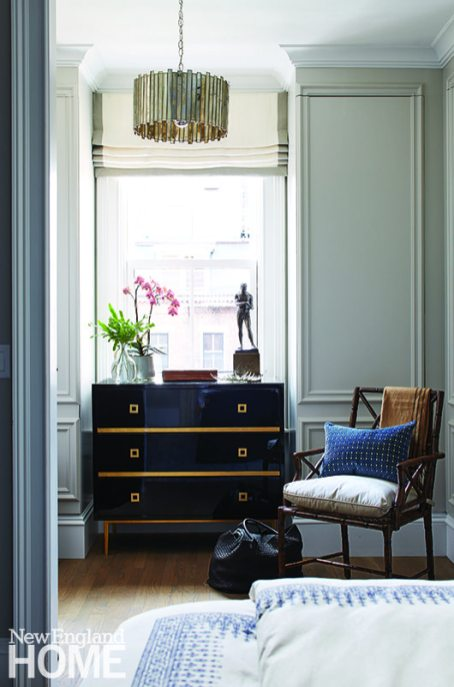 The lovely dressing room vignette features a Hudson rosewood chest and a faceted drum pendant, both from Worlds Away. The Gillow armchair is from Hickory Chair.