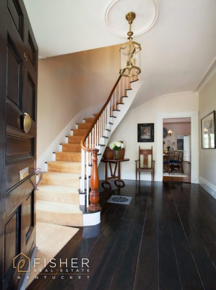 Guests are welcomed with a grand staircase and wide plank floor boards.