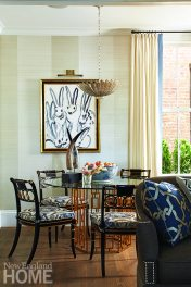 Demonstrating more fearless decorating, Acevedo surrounded a gold leaf Jackson table with re-covered antique Governor Alston Regency-style chairs and illuminated the scene with a striking silver-leaf chandelier.