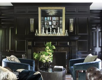 Glossy black library fireplace