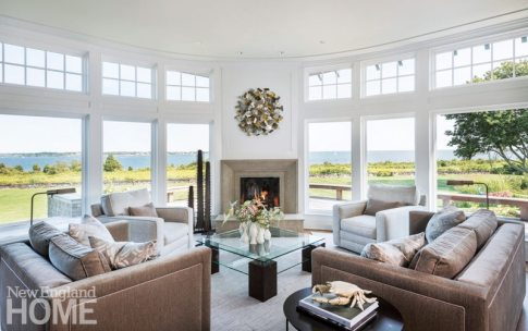 """In the living room, windows with muntins above eye level help emphasize the location. """"From inside the house they act like picture windows,"""" Hanlon says."""