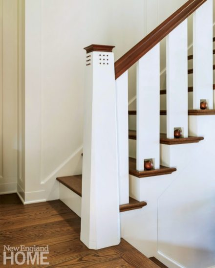 Hanlon reworked the existing stairs, adding new treads, railings, and exclamation-like oak ball accents.
