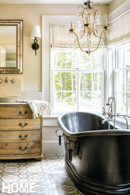 Master bathroom with black claw footed tub