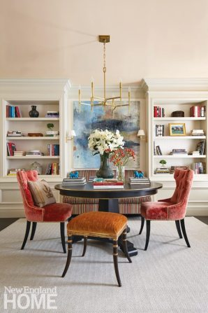 The front room doubles as a reception area and a formal dining room, with a custom table that expands to seat eight.