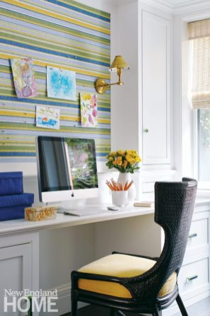 An office area echoes the blue and green shades of the neighboring kitchen and family room.