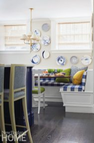 Christopher Spitzmiller plates adorn the wall above the breakfast banquette, which is covered in an indoor/outdoor fabric.
