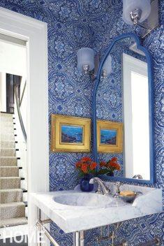 A bold wallpaper dissolves boundaries in the diminutive basement powder room.