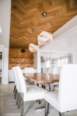 A herring bone ceiling and accent wall created by Mac Davis Flooring define this home's dining and entertaining area.