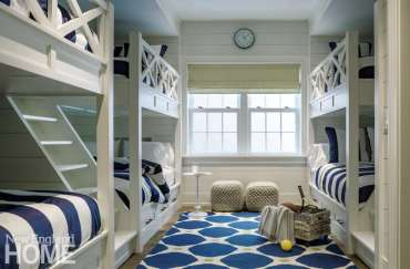 A guest bunkroom in the basement can sleep six in cozy bunkbeds.