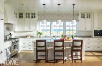 The kitchen's classic six-over-six windows boast picture-postcard views of Nantucket Sound, easily visible from the island with its New Kashmir white granite top.