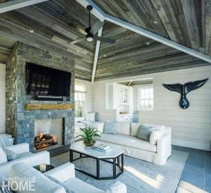 The more rustic pool house features a ceiling of reclaimed barn board, lightly washed cypress walls, and a carved whale's tail from a local artist.