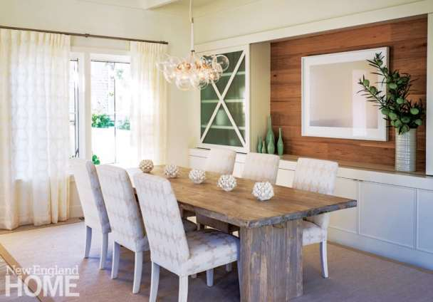 White-oak paneling lends a quiet warmth to the dining room.
