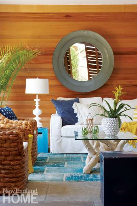 A transparent stain plays up the rich cedar wall in the sitting area.