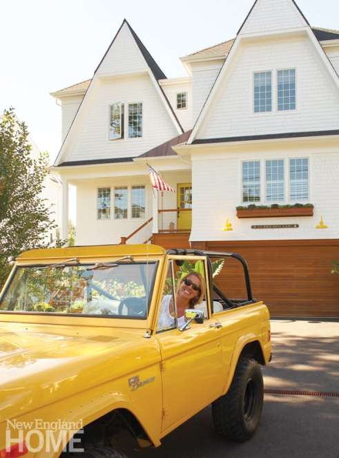 The new house, a replacement for the old cape demolished by Hurricane Sandy, is elevated to withstand flooding. A yellow door and yellow outdoor lights make a happy match for the bright Bronco the designer drives.