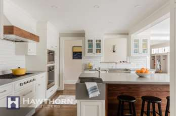 One of the kitchen's highlights is a concrete countertop and custom corner sink crafted by RockMill Countertops in Rumford, Rhode Island.