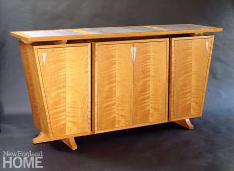 """Keystone trestle sideboard in curly cherry and """"tiger"""" stainless steel."""