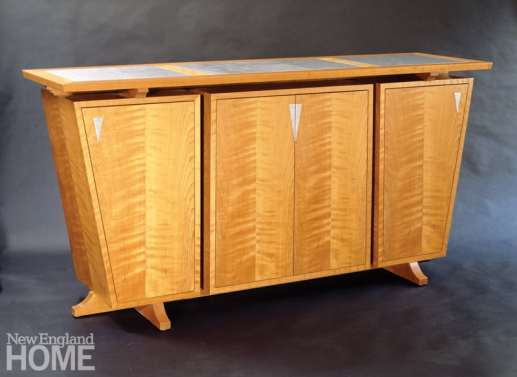 "Keystone trestle sideboard in curly cherry and ""tiger"" stainless steel."