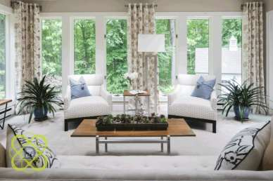 Expansive windows create a beautiful connection between outdoors and in. Furnishings and window treatments were selected to work in harmony with the home's natural setting.