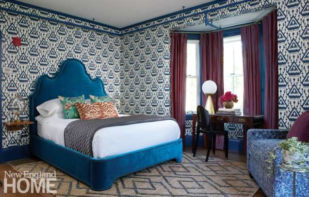 Guest room with bold wallpaper