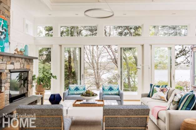 Strategic splashes of color in the living room tease the eye without distracting from the views.