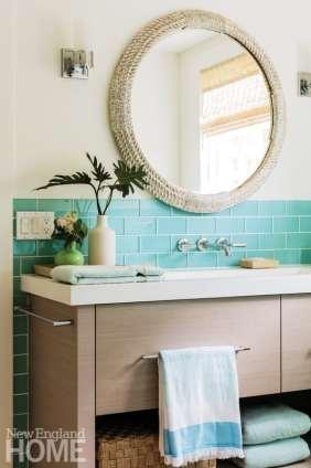 Aqua Ann Sacks oversize glass subway tiles form the backsplash in the master bathroom.