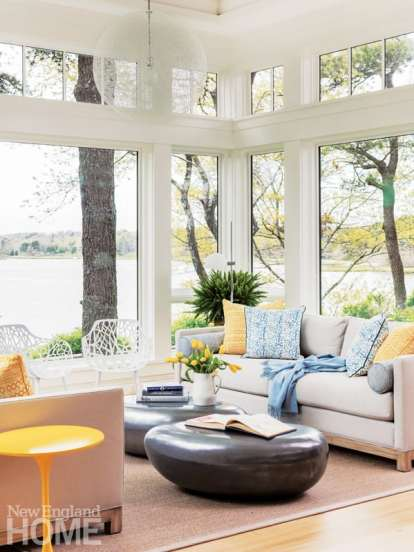See-through white JANUS et Cie Forest chairs and a gossamer Moooi pendant light leave the view from the sitting room unobscured.