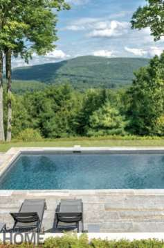 Multiple outdoor spaces, including the lower swimming pool area located at the edge of the drop-off, give the owners a choice of destinations.