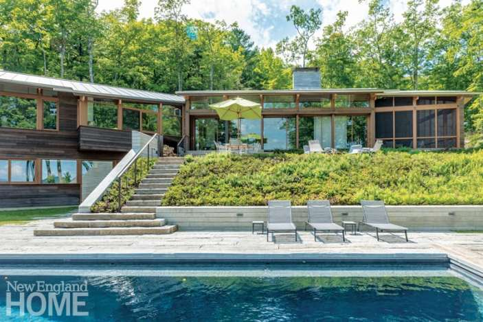 """Retractable glass doors with screens that drop from interior soffits allow the home's east-facing living area to marry with the outdoors. """"The views are killer,"""" says Matthew Cunningham."""