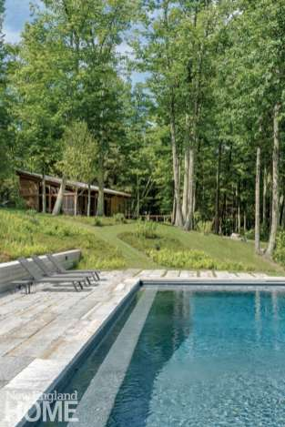 A manicured path winds its way from the heavenly pool to the guest cabin.