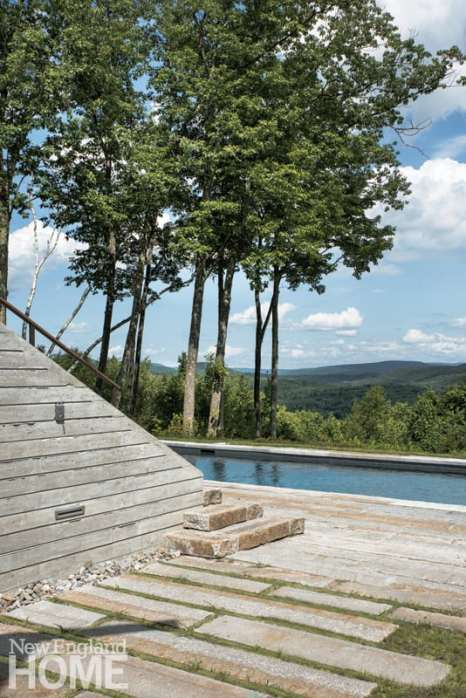 On the lower terrace, horizontal bands of lawn and stone lead to the pool, bringing a sculptural element to the landscape.