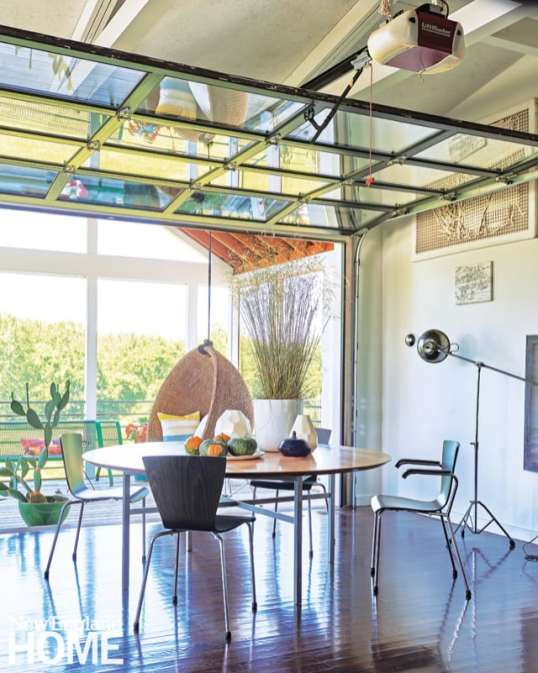 The interior and the screened porch become one when a glass garage door is raised.