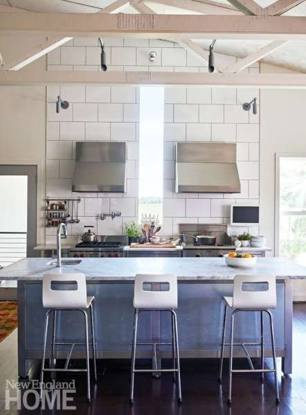 A stainless-steel and galvanized metal island defines the kitchen.