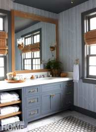 Master bathroom with blue cabinetry