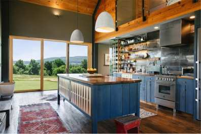 Cabin kitchen with blue cabinetry and large window copy