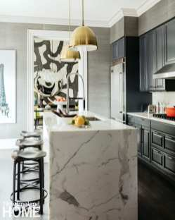 Kitchen with marble waterfall style island