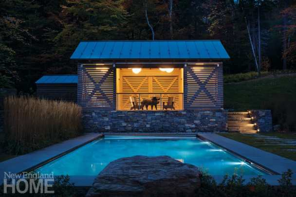 Pool house Stowe, Vermont home designed by Michele Foster at night