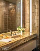 Contemporary powder room with polished marble and tile