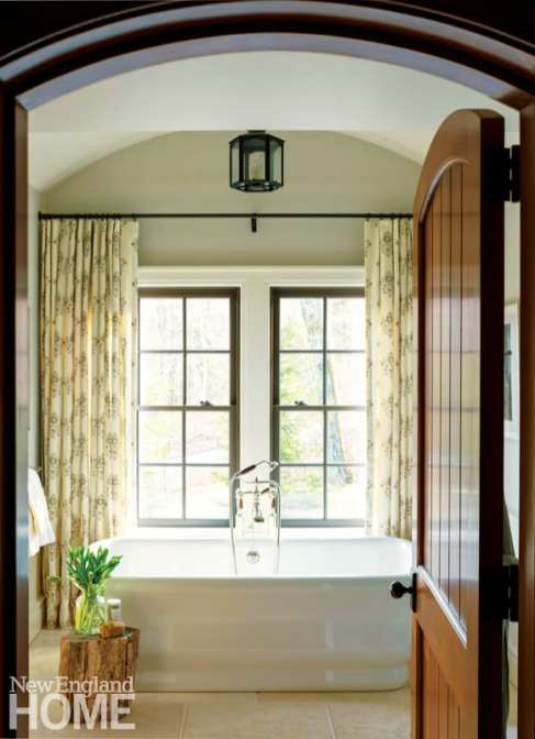 The master bath is one of the few rooms where curtains were used, softening the windows while imparting a sense of privacy.