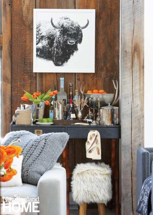 cocktail bar, orange flowers, buffalo art, console
