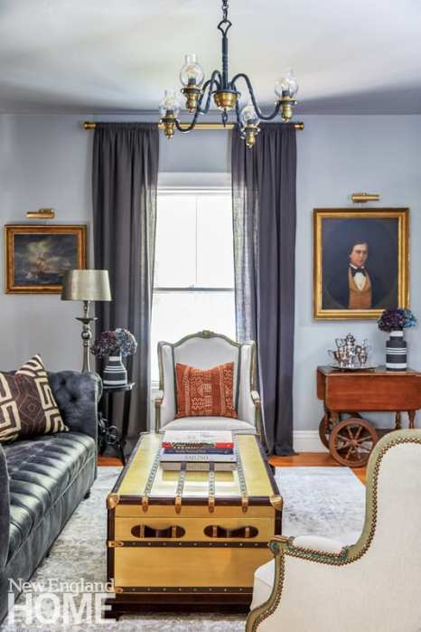 antique portraits, chesterfield sofa, African-print pillows, living room