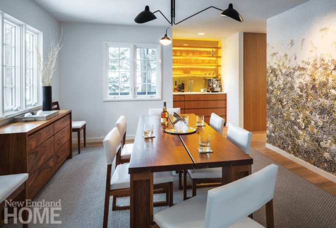 The old dining room was updated with a lemon-colored bar and fanciful wallpaper.